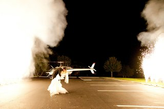 couple-kissing-outside-with-helicopter-and-sparklers