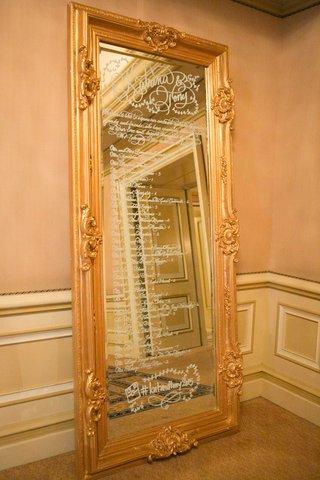 seating-chart-long-mirror-reflective-white-writing-calligraphy-katrina-modern-wedding-decor