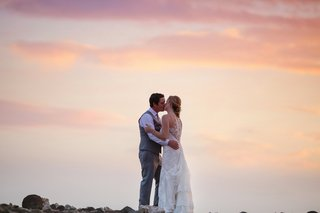 bride-and-groom-kiss-at-sunset-maui-wedding