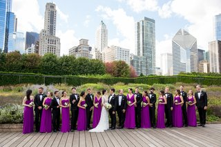 bride-in-lace-v-neck-carolina-herrera-groom-in-ralph-lauren-bridesmaids-in-bright-purple-dresses