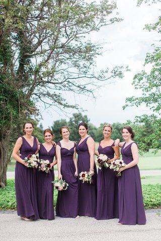 bridesmaids-in-floor-length-purple-eggplant-bridesmaid-dresses-mismatched-necklines-bouquets