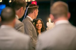 bride-and-groom-wearing-crowns-during-traditional-greek-orthodox-wedding-ceremony-hunter-pence