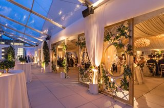 tent-wedding-view-from-cocktail-hour-space-into-reception-ballroom-drapery-and-open-clear-top-tent