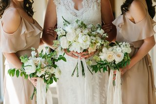 bride-with-bridesmaids-in-tan-dresses-white-bouquets-greenery-with-peony-rose-flowers