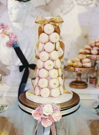 tower-of-light-pink-french-macarons-with-gold-flakes-at-wedding-dessert-bar