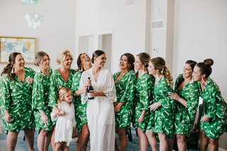 palm-print-green-getting-ready-robes-miami-wedding-bride-in-long-white-robe-with-flower-girl-match