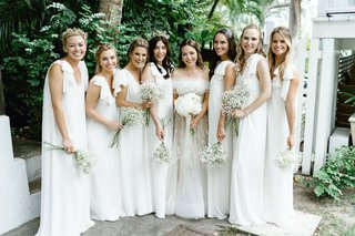 bride-and-bridesmaids-in-white-dresses-harbour-island-destination-wedding-bahamas-babys-breath