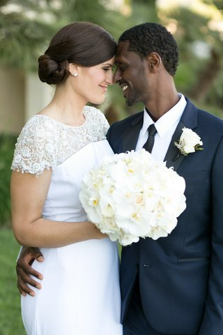 couple-nose-to-nose-wedding-attire-southern-california-nuptials-lace-navy-white-flowers