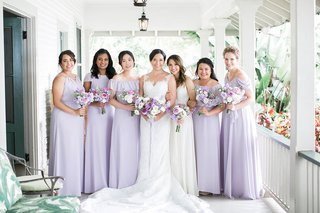 bridesmaids-in-mismatched-light-purple-bridesmaid-dresses-and-bouquets-maid-of-honor-in-white-dress