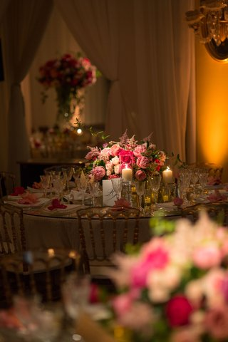 wedding-reception-romantic-candlelight-on-round-table-with-candles-and-crystal-glassware-peony-rose