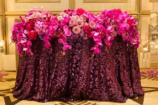 pink-and-purple-floral-arrangements-orchids-roses-linens-reception-cascading