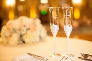 bride-and-grooms-champagne-flutes-with-silver-stems-crystals-and-couples-names