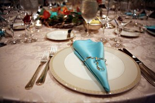 ivory-plate-with-light-blue-satin-napkin-with-crystal