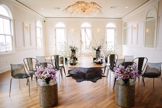 edgy-alternative-wedding-inspiration-black-ceremony-chairs-cow-rug-for-aisle-runner-lavender-flow
