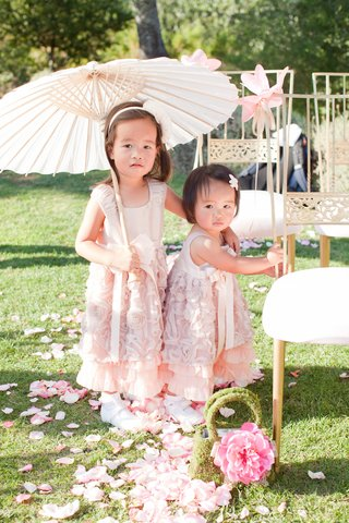 outdoor-wedding-with-two-flower-girls-in-sleeveless-blush-dresses-rosette-skirts-ribbon-sashes