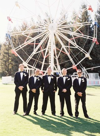 groomsmen-in-tuxedos-with-bow-ties-at-calamigos-ranch-ferris-wheel