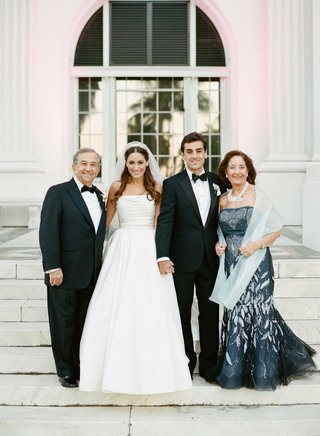 mother-of-groom-in-strapless-evening-gown-carolina-herrera-with-shawl-and-necklace-father-of-groom