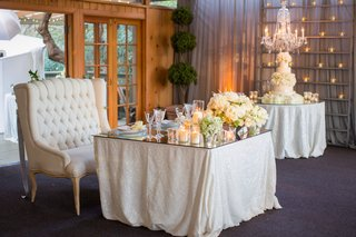mirrored-sweetheart-table-with-glittery-white-linens-and-a-mirror-table-tufted-loveseat