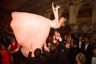 wedding-reception-jewish-hora-dance-bride-being-tossed-up-in-air-by-guests-reem-acra-dress