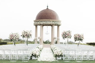 wedding-ceremony-on-grassy-lawn-resort-at-pelican-hill-white-pink-flowers-greenery