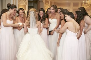 bride-with-excited-bridesmaids-outside-ceremony