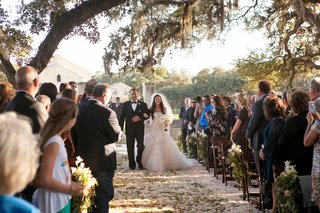 bride-in-monique-lhuillier-wedding-dress-with-father-of-bride-in-tuxedo-at-rustic-outdoor-wedding