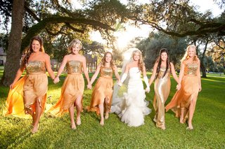 bride-in-white-gloves-with-bridesmaids-in-golden-gowns
