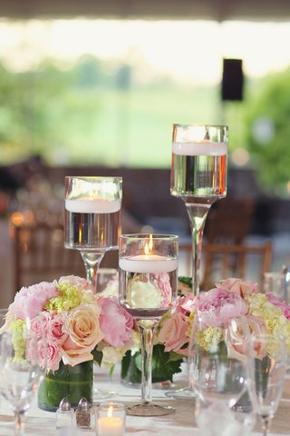 floating-candles-in-monet-glass-vases-and-short-arrangements
