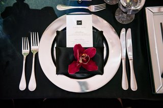 wedding-reception-place-setting-silver-charger-plate-black-napkin-burgundy-orchid-menu-monogram