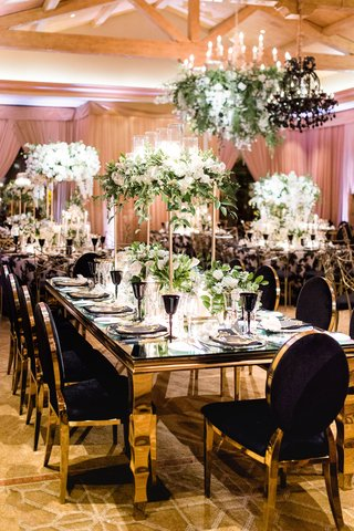 charlise-castro-and-george-springer-wedding-reception-table-black-chair-velvet-gold-table-flowers