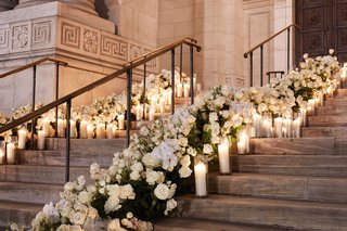 wedding-at-new-york-public-library-white-rose-flowers-candles-in-hurricane-vases-outdoor-staircase
