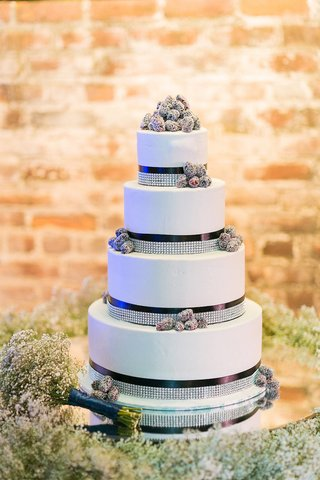 white-wedding-cake-with-navy-blue-ribbons-rhinestone-bands-and-clusters-of-blackberries