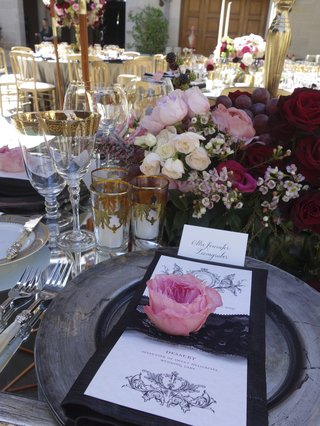 grey-charger-plate-and-pink-flower-topper-on-menu