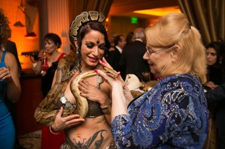 guest-at-moroccan-themed-engagement-party-holds-belly-dancers-snake