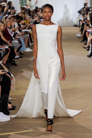 ines-di-santo-fall-2019-bridal-collection-wedding-dress-rae-bateau-neckline-cigarette-leg-jumpsuit