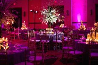 indoor-wedding-reception-with-magenta-lighting