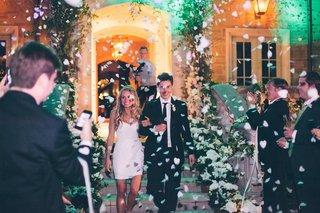 newlyweds-walking-through-bio-degradable-paper