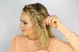 bride-putting-together-fishtail-braid-for-wedding-day-hairstyle
