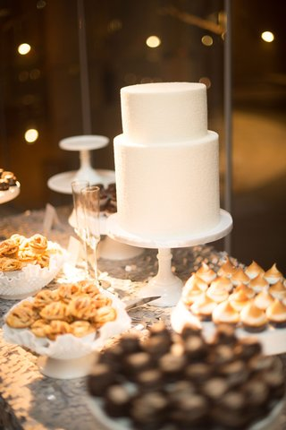 two-layer-cake-and-dessert-bar-on-sequin-linen