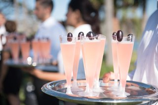 light-pink-cocktail-in-champagne-glasses-served-at-beachside-wedding-cocktail-hour