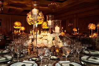 wedding-reception-low-rose-centerpiece-flowers-with-candles-in-tall-candlesticks
