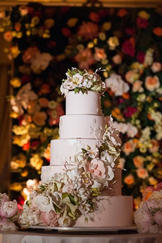 five-layer-wedding-cake-with-flowers-and-light-pink-fondant