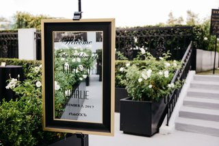 wedding-welcome-sign-on-mirror-with-black-and-gold-frame