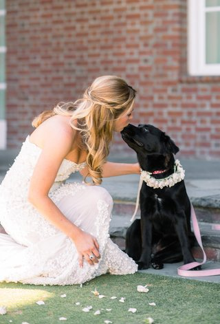 bride-in-zuhair-murad-kisses-flower-girl-dog-black-lab