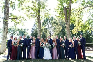 outdoor-wedding-photo-portrait-wedding-party-bridesmaids-pink-mauve-burgundy-groomsmen-in-blue-suits