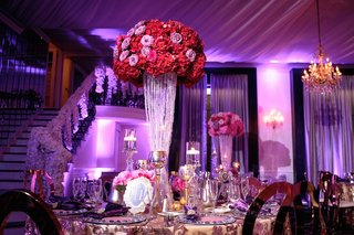 gold-table-linen-tall-centerpiece-red-pink-purple-flowers-gold-candle-votives-floating-candle-purple