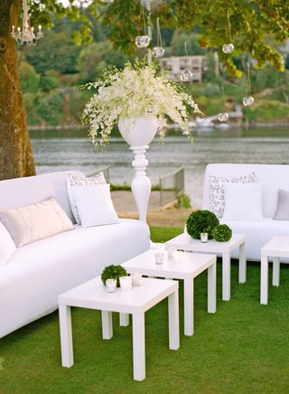 white-lounge-furniture-on-grass-with-view-of-river