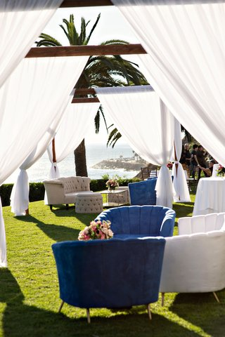wedding-reception-with-view-of-beach-and-ocean-green-lawn-tufted-furniture-grey-blue-white-lounge