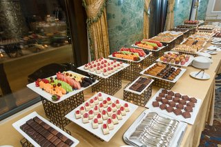 dessert-table-at-wedding-with-fruits-chocolates-and-pastries
