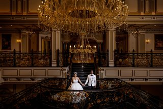 bride-and-groom-at-the-legacy-castle-in-new-jersey-new-wedding-venue-ball-gown-headpiece-nfl-wedding